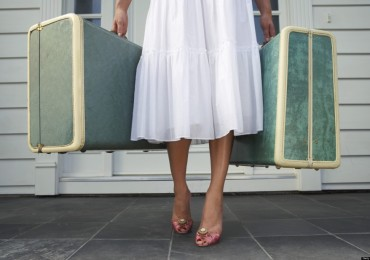 woman-with-suitcases-1024x683